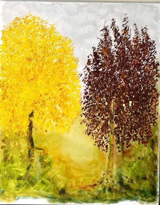 Deux arbres aux différentes couleurs d'automne