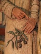 mains d'ambrogio tenant un rameau d'olivier